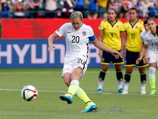 United States forward Abby Wambach (20) kicks a penalty