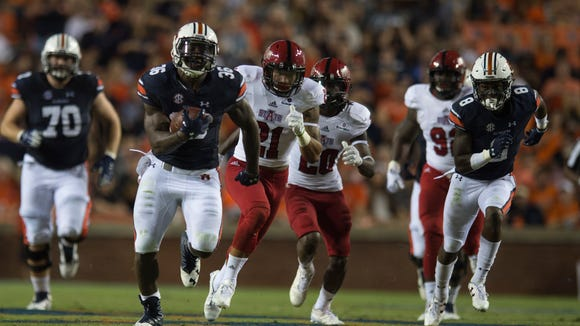 Auburn running back Kamryn Pettway (36) runs downfield