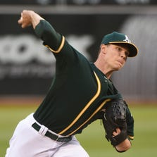 August 22, 2014; Oakland, CA, USA; Oakland Athletics starting pitcher Sonny Gray (54) delivers a pitch against the Los Angeles Angels during the first inning at O.co Coliseum.