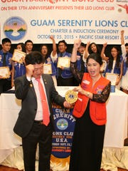 Lions Club International First Vice-District Governor, Lynda Tolan, left, and Lions Club International District Governor, Daniel J. Yang, center, and Guam Harmony Lions Club President, Loisa Cabuhat, right, celebrate the chartering of the new Guam Serenity Lions Club.