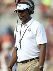 FSU's Willie Taggart watches his team play during the