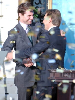 Tom Cruise, left, with leader of the Church of Scientology, David Miscavige.