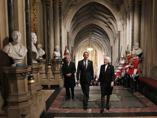 Then-President Obama, escorted by John Bercow, left,