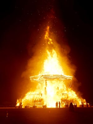 Fire consumes the base of the Man structure at Burning Man on Saturday, Sept. 2, 2017.