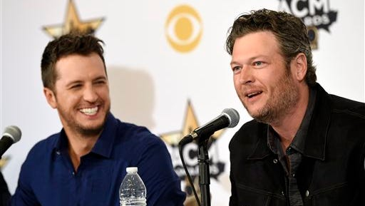 Blake Shelton, right, and Luke Bryan, co-hosts of Sunday's 50th Academy of Country Music Awards, laugh during a news conference on the event at AT&T Stadium on Friday.