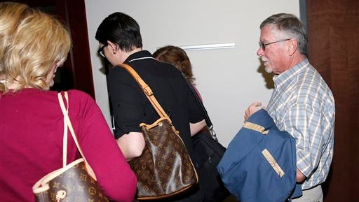 In this Dec. 8, 2014 file photo, Robert Holmes, far right, father of theater shooting suspect James Holmes, heads into a pre-trial readiness hearing in Centennial, Colo., in the murder trial of his son, who is charged with killing 12 moviegoers and wounding 70 more in a shooting spree in a crowded theater in Aurora, Colo., in July 2012.