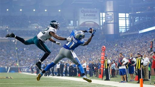 Eagles cornerback Eric Rowe tries in vain to break up a touchdown pass to Calvin Johnson on Sunday. Johnson had three touchdowns in the game.