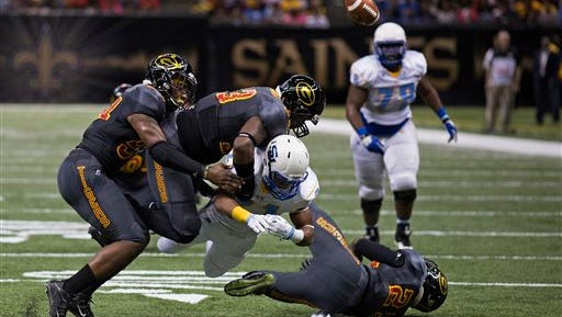 Southern University Jaguars running back Lenard Tillery (21) loses the ball after being tackled by Grambling State in the first half of the Bayou Classic Saturday.