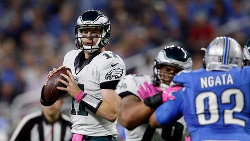 Eagles quarterback Carson Wentz looks downfield during the first half the Eagles' 24-23 loss to the Detroit Lions on Sunday.