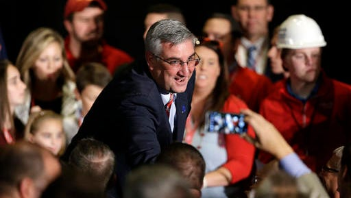 Republican gubernatorial candidate Lt. Gov. Eric Holcomb thanks supporters after winning his race at an election night rally in Indianapolis, Tuesday, Nov. 8, 2016. (AP Photo/Michael Conroy)