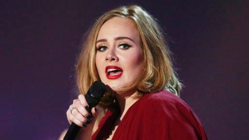 FILE - In this Feb. 24, 2016 file photo shows Adele onstage at the Brit Awards 2016 at the 02 Arena in London.  The Recording Academy announced Friday, Jan. 20, 2017,  that Adele will perform at the Feb. 12 show at the Staples Center in Los Angeles. Previously announced performers include Metallica, Carrie Underwood, John Legend and Keith Urban.