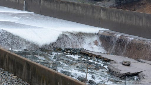 Some concrete of the Lake Oroville Dam's spillway is seen damaged in Oroville on Tuesday. Authorities said there's no damage to the dam itself, and that there's no danger to the public.