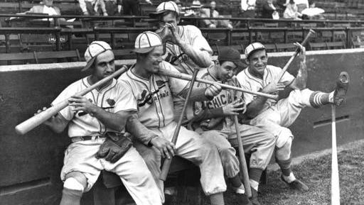FILE - In this Sept. 30, 1938 file photo, Rip Collins, Chicago first baseman and former Cardinal, joined his old teammates in a burlesque of John Pepper Martin's mudcat band in St. Louis, from left, Stan Bordagaray, Bill McGee, Collins, and Pepper himself are dancing out a on their bats, while Bob Weiland (standing, rear) finds his glove sufficient. The Abraham Lincoln Presidential Museum plans to unveil an exhibit chronicling the history of the rivalry between the Chicago Cubs and the St. Louis Cardinals opens March 24, 2017 in Springfield, Ill.