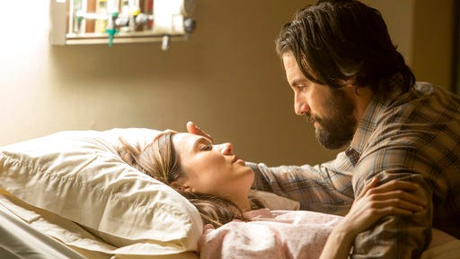 "This image released by NBC shows Mandy Moore, left, and Milo Ventimiglia in a scene from ""This Is Us."" The season finale for the popular  time-twisting family drama will air Tuesday at 9 p.m. EST on NBC."
