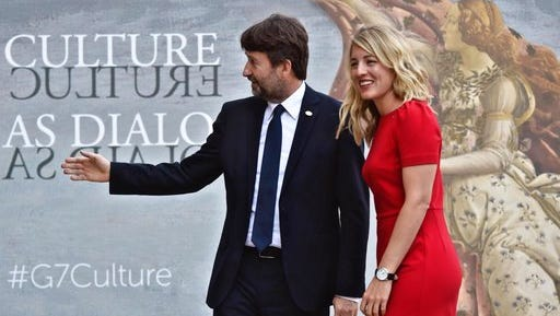 Canada's Culture Minister Melanie Joly, right, is welcomed by Italian Culture Minister Dario Franceschini as she arrives for a first-ever G7 Culture ministers meeting in Florence, Italy, March 30, 2017.