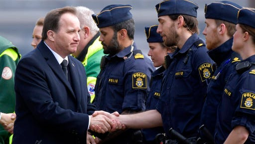 Sweden's Prime Minister Stefan Lofven greets police officers during a ceremony at Stockholm City Hall, Monday, April 10, 2017, to honor the four killed victims and 15 injured in a fatal truck attack. The attack was allegedly carried out by an asylum-seeker from Uzbekistan who drove the stolen vehicle into a crowd of shoppers on a busy Friday afternoon in downtown Stockholm.