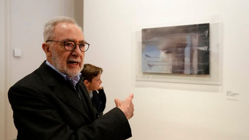 German painter Gerhard Richter stands in front of his work during a press preview for his exhibition downtown Prague, Czech Republic, Tuesday, April 25, 2017. The exhibition starts on April 26, 2017 and last until Sept. 3, 2017.