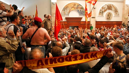 Protestors enter into the parliament building in Skopje, Macedonia, Thursday, April 27, 2017. Scores of protesters have broken through a police cordon and entered Macedonian parliament to protest the election of a new speaker despite a months-long deadlock in talks to form a new government.
