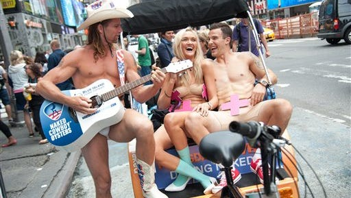 """Couples take a ride in a pedicab to promote the new VH1 series """"Dating Naked"""" on July 16 in New York City."""