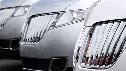 A row of 2014 Lincoln MKX SUVs are lined up on the lot of the dealership in Wexford, Pa. General Motors, Ford, Nissan and Chrysler all reported big gains as the major automakers reported July sales today.