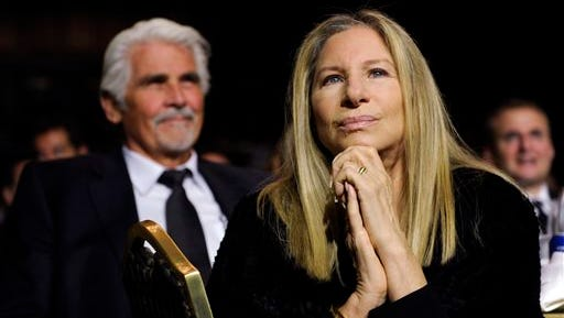 """Barbra Streisand listens to President Barack Obama speak at the USC Shoah Foundation?s 20th anniversary Ambassadors for Humanity gala in Los Angeles. Streisand's husband, James Brolin, sits at left. Publisher Taschen announced Wednesday """"Barbra: Streisand's Early Years in Hollywood, 1968-1976"""" will be published in December. According to Taschen, the book will include more than 240 images, many of them never published before."""