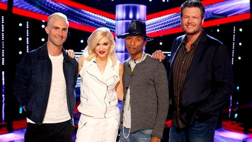 "This photo released by NBC shows, from left, Adam Levine, Gwen Stefani, Pharrell Williams, Blake Shelton on the set of ""The Voice,"" premiering on Monday."