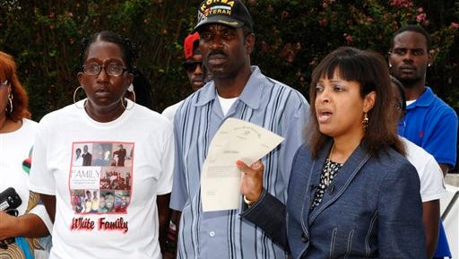 Vanessa White (from left) and Victor White Sr. listen as attorney Carol Powell-Lexing speaks during a news conference in New Iberia Wednesday about the shooting of Victor White III. Authorities say 22-year-old White III died on March 2 in the back seat of an Iberia Parish Sheriff's Office car, with his hands bound behind his back.