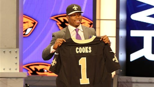 Brandin Cooks poses with his jersey after being selected by the New Orleans Saints at the 2014 NFL Draft at Radio City on Thursday, May 8th, 2014 in New York, NY.  (AP Photo/Gregory Payan)