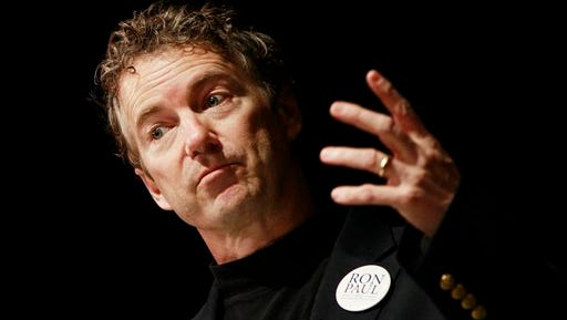"""FILE - In this Jan. 7, 2012 file photo, Sen. Rand Paul, R-Ky., son of Republican presidential candidate, Rep. Ron Paul, R-Texas, campaigns for his father at Windham High School in Windham, N.H. Paul says he was stopped briefly by security at the Nashville airport, Monday, Jan. 23, 2012, when a scanner found an """"anomaly"""" on his knee. (AP Photo/Charles Dharapak, File)"""