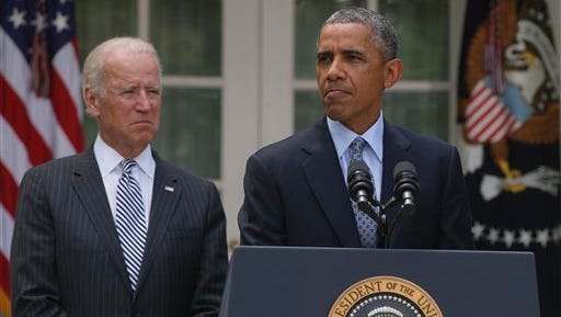 President Barack Obama stands with Vice President Joe Biden as he speaks about immigration in the Rose Garden at the White House in Washington, Monday, June 30, 2014. House Speaker John Boehner told President Obama that the House will not vote on overhauling the nation?s troubled immigration system during this election year, the White House says. Officials say Obama will announce steps Monday to deal with immigration through executive actions without congressional approval. (AP Photo/Charles Dharapak)