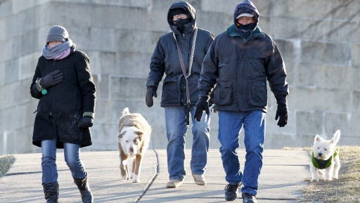 South Boston residents take dogs for a walk in January 2013 when temperatures dipped into the teens.