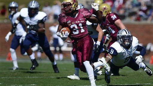 Elon University wide receiver Kierre Brown breaks away from University of New Hampshire cornerback Lamar Edmonds during the NCAA football game at Elon University in Elon, N.C. Saturday, Oct. 4.
