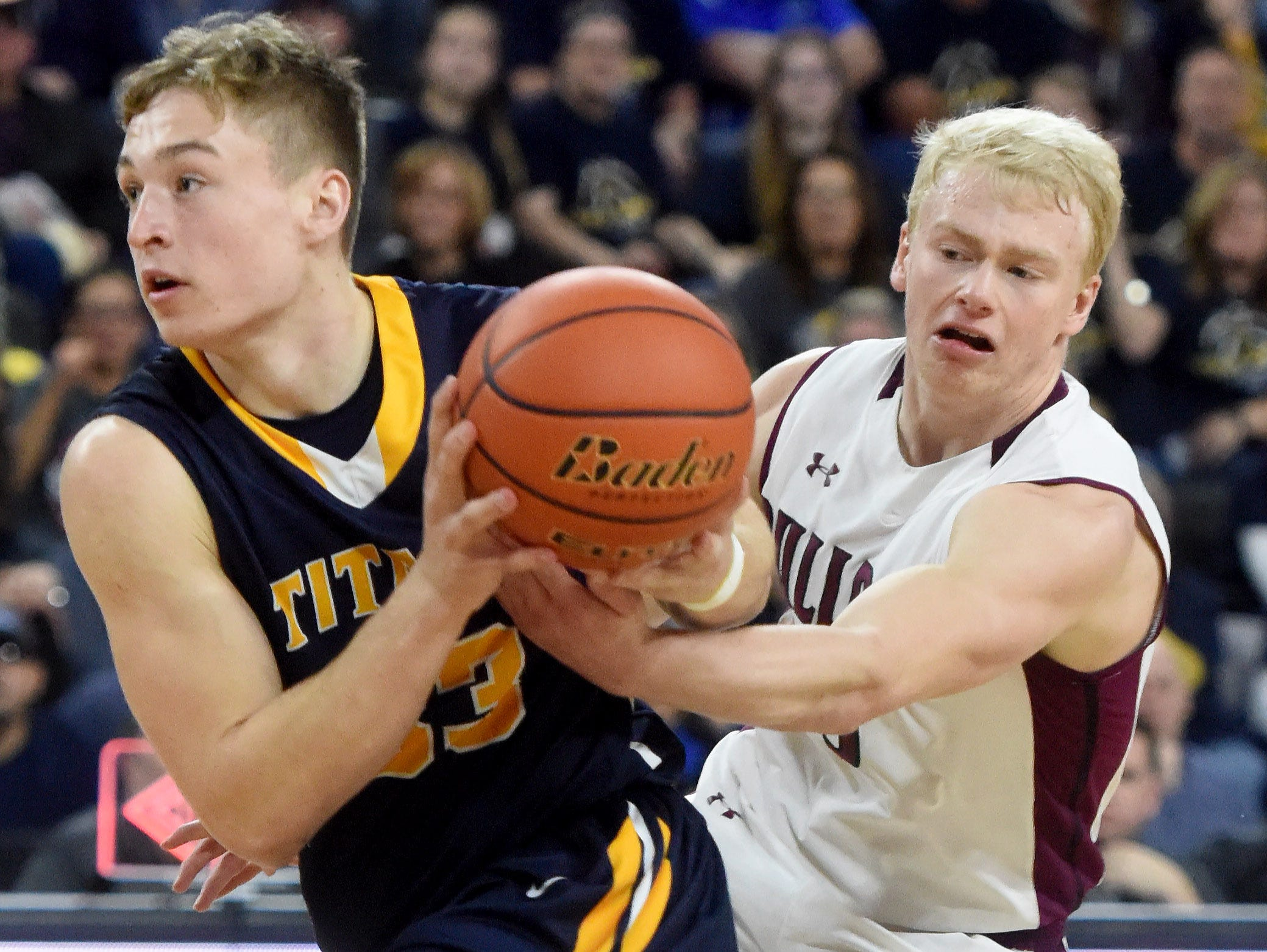 Tea Area's Payton Conrad moves toward the basket while Madison's Mason Leighton defends during the 2017 SDHSAA Class A boy's basketball championship at the Denny Sanford Premier Center on Saturday, March 18, 2017.