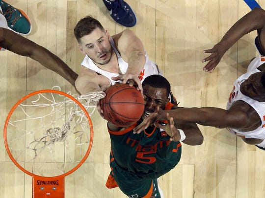 Syracuse's Tyler Lydon, above, a Pine Plains graduate, fights Miami's Davon Reed for a rebound on March 8 in Brooklyn.
