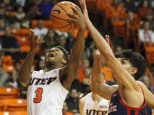 UTEP freshman Evan Gilyard, 3, drives to the basket against Florida Atlantic Thursday night.