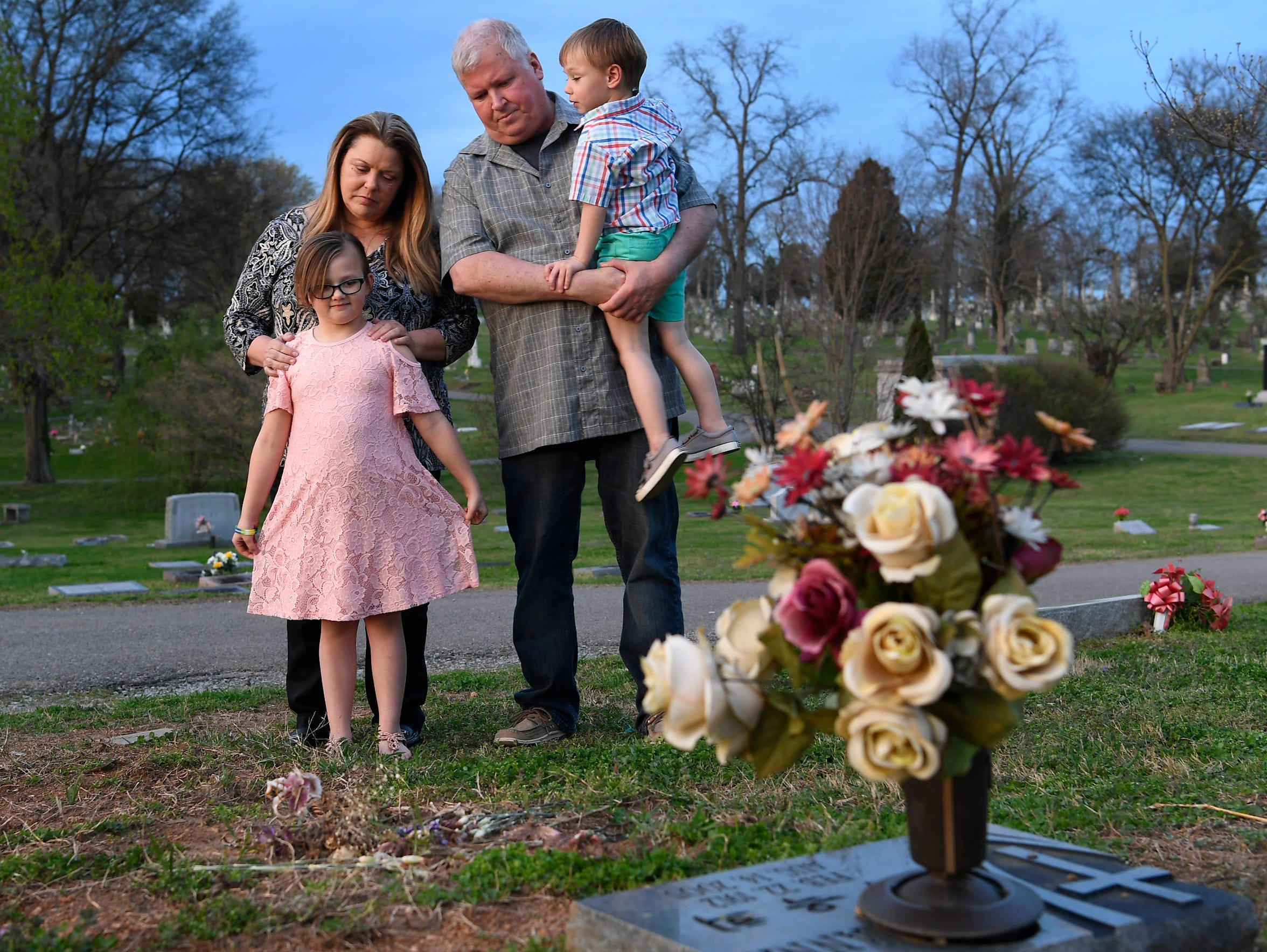 Tina and Mickey Baltz stand with their grandchildren,