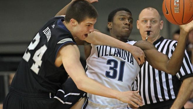 Butler Bulldogs' Kellen Dunham, left, has the ball stripped from his possession by Villanova Wildcats' Dylan Ennis, right, during the first half in Villanova, Pa., on Wednesday, Feb. 26, 2014. (Michael Bryant/Philadelphia Inquirer/MCT)
