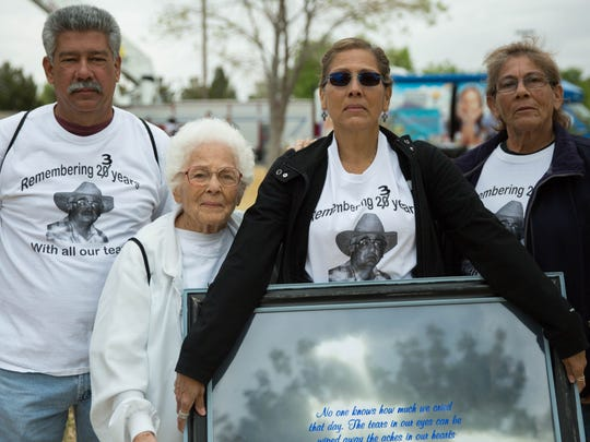 Chuy Garibay, Emilia A. Rocha, Becky Garibay and Rachel Rocha stand with a framed picture remembering her brother Robert Rocha, who was murdered in 1994. The family gathered at the National Crime Victims' Rights Week event at Young Park on Saturday, April 1, 2017 to help keep awareness of Roberts' still unsolved murder.