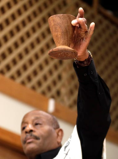 The unity cup (Kkimbe cha Umoja) is filled with libations – usually water, grape juice or wine – that is poured out for the ancestors.