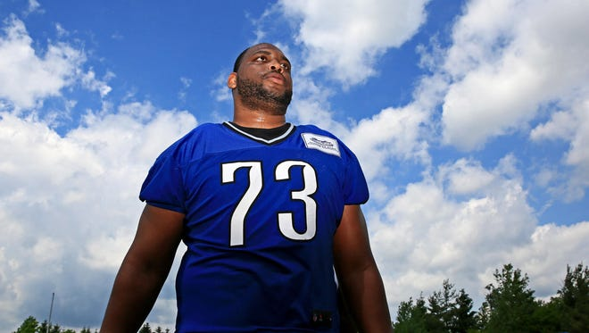 Detroit Lions tackle Michael Williams looks on during OTAs in Allen Park.