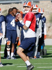 Senior quarterback Zack Greenlee puts his team through drills during practice Tuesday morning as the Miners prepare for their next opponent, UTSA, in the Sun Bowl on Saturday night. Greenlee and UTEP's second quarterback, junior Ryan Metz, shared the snaps during practice since, as of now, no starter has been named for Saturday's game.