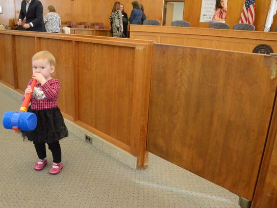 Lia Smith wandered the courtroom with a toy gavel after