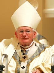 In this Nov. 12, 2006, file photo, Baltimore Cardinal William Keeler listens during the Bishops' Mass at The Baltimore Basilica in Baltimore. Keeler, who helped ease tensions between Catholics and Jews, has died. (AP Photo/Chris Gardner, File)