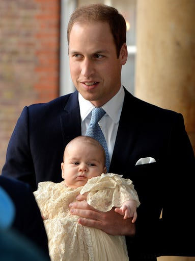Today's the big day! Prince George is getting christened. Prince William holds his son as they arrive at Chapel Royal in St James's Palace in London.