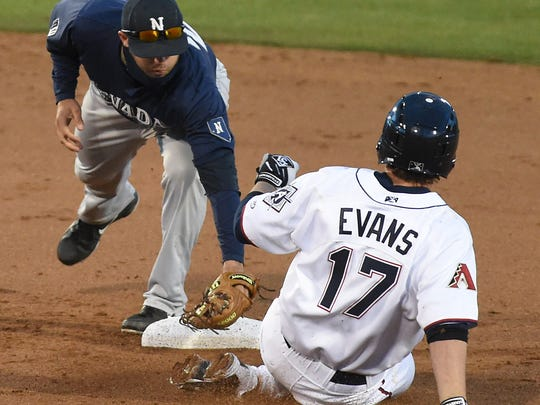 Nevada's Ryan Howell reaches to tag the Aces' Nick Evans at second base in the Tuesday's annual exhibition game at Aces Ballpark on Tuesday. Evans was called out in the play.