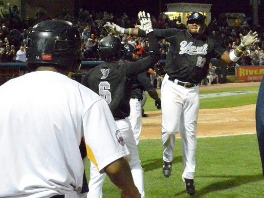 Telvin Nash, #23, is greeted by his York Revolution