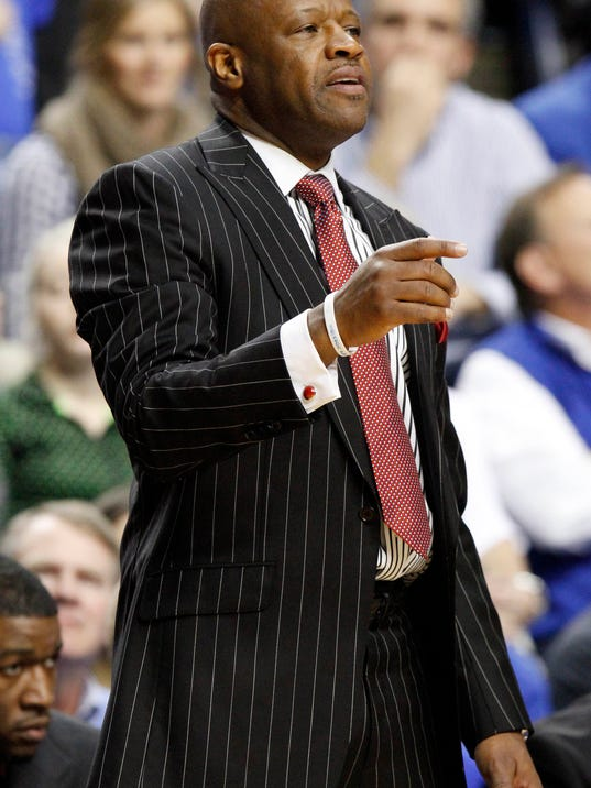 Arkansas coach Mike Anderson watches during the second half of an NCAA college basketball game against Kentucky, Thursday, Feb. 27, 2014, in Lexington, Ky. Arkansas won 71-67 in overtime. (AP Photo/James Crisp)