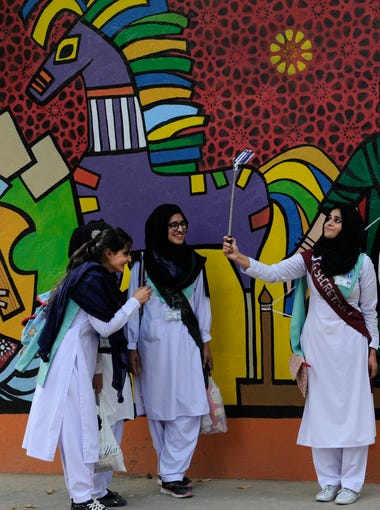 Lok Virsa Museum is a regular stop for school groups. This group of girls was excited to grab a selfie with the U.S. visitors to the museum -- also known as the National Institute of Folk & Traditional Heritage -- as well as snap a variety of selfies of themselves with the folk art as the background.