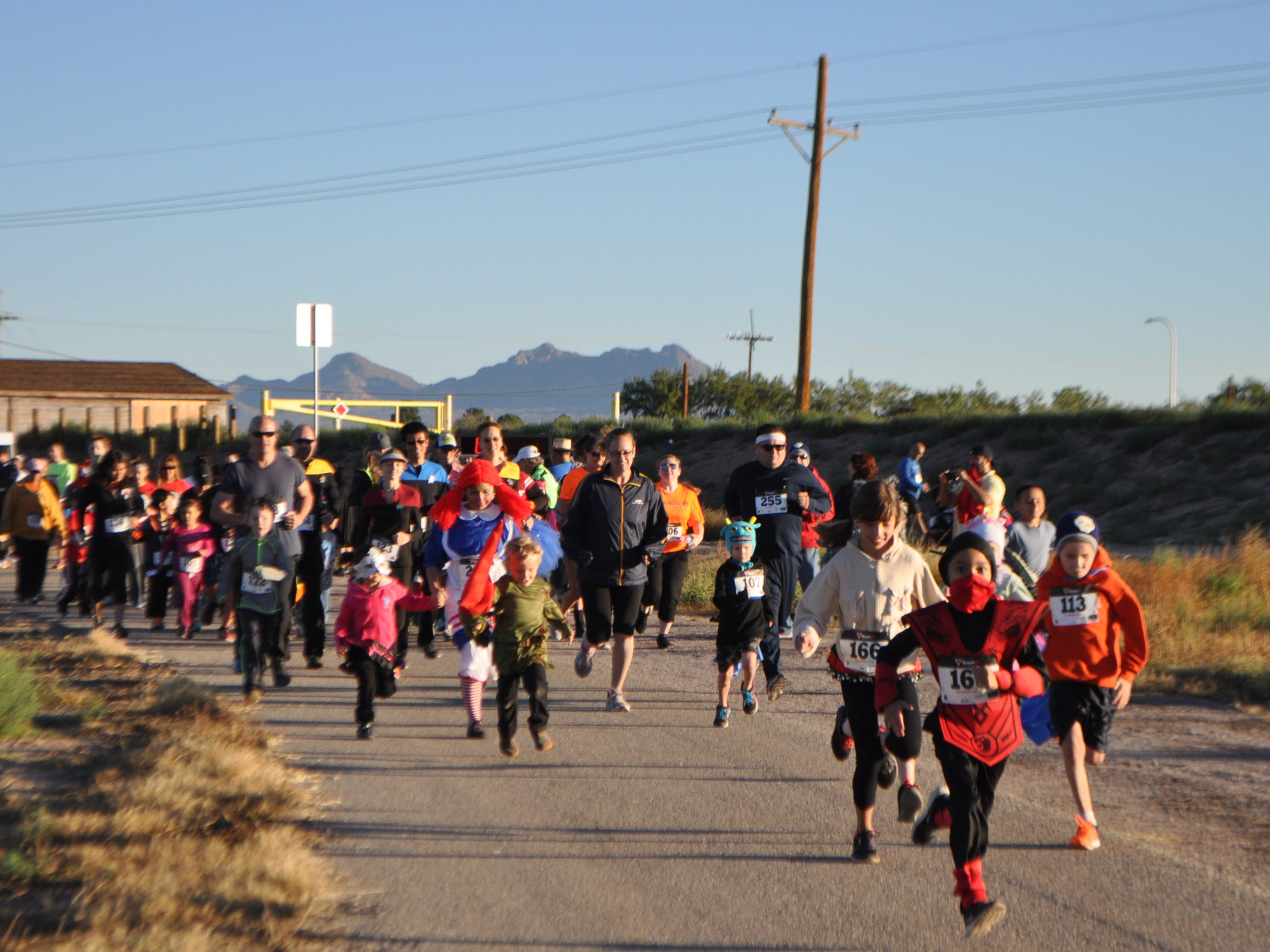 Adults and children participate in the 2014 Las Cruces Monster Run at La Llorona Park. Last year, the Monster Run attracted 184 people and more are expected to attend this year's race.