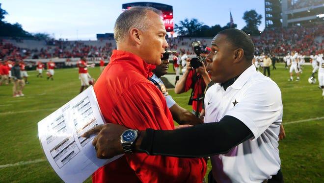 Georgia coach Mark Richt, left, and Vanderbilt coach Derek Mason talk after last season's game.